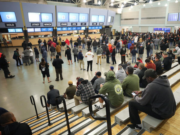 Workers say this union hall is usually packed with over 1,000 people waiting for daily jobs at the ports of Los Angeles and Long Beach — but shipments from China are down because of the coronavirus crisis.