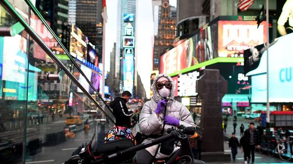 A woman in Times Square in New York wears a face mask against the coronavirus on Tuesday.