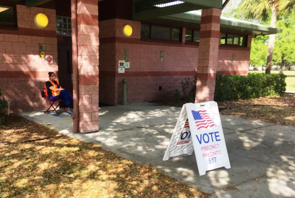 Poojah Pandya of Tampa sits alone outside a polling place in Northdale, north of Tampa