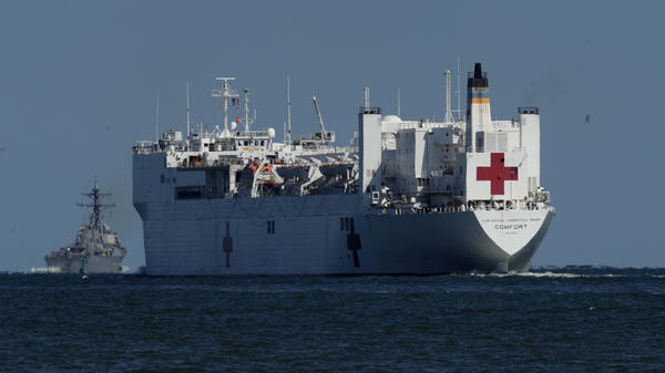 The USNS Comfort, seen in 2017, is one of two U.S. Navy hospital ships, along with the USNS Mercy, that are preparing to deploy to assist medical workers expecting to grapple with an influx of patients in the weeks to come.