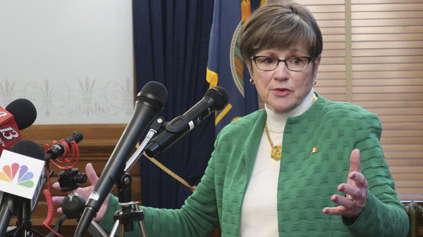 Kansas Gov. Laura Kelly addresses a news conference Tuesday in Topeka, Kan., after announcing the closure of schools K-12 throughout the state for the rest of the school year.