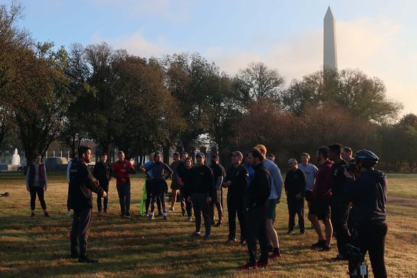Michael Rodriguez, left foreground, president of a group that wants to build a 'Global War on Terrorism' memorial, shows the proposed site to several supporters after a Nov. 2019 sunrise run on the National Mall.