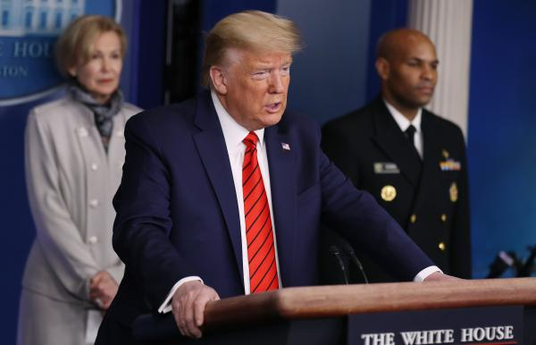 President Trump provides the latest developments of the coronavirus outbreak at the White House on Thursday. He is joined by White House coronavirus response coordinator Deborah Birx and U.S. Surgeon General Jerome Adams.