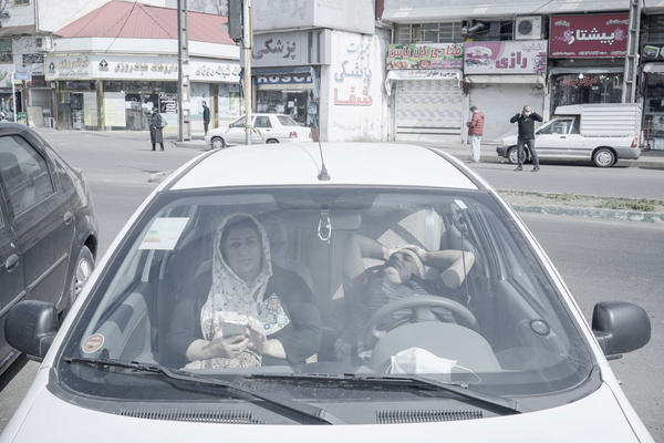 Patients wait in their car instead of waiting in the hospital in Guilan, Iran.