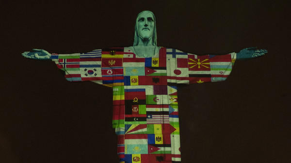 The Christ the Redeemer statue in Rio de Janeiro, Brazil, was lit up with the flags of countries currently afflicted by the coronavirus.