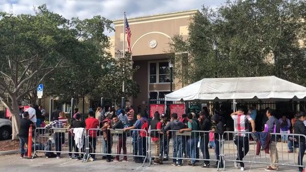 Immigrants lined up outside the ICE facility in Miramar last year.