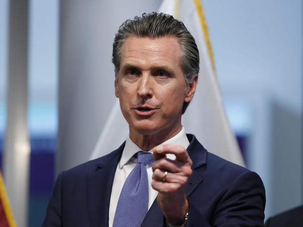 California Gov. Gavin Newsom, seen on Tuesday, ordered Californians on Thursday night to stay home except for groceries and the like, to slow the spread of the coronavirus.