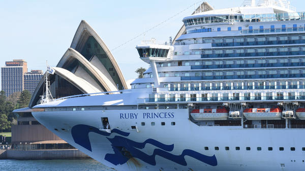 Ruby Princess departs Sydney Harbour on Thursday. Three passengers and one crew member aboard the vessel have tested positive for the novel coronavirus.