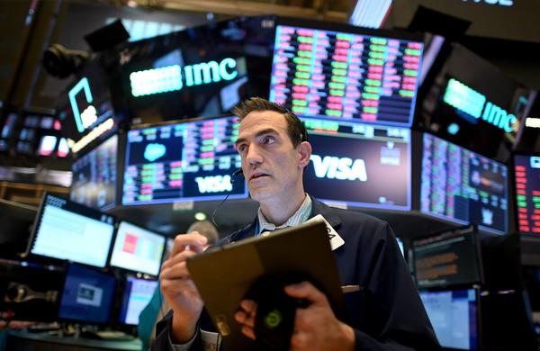 Traders work during the closing bell at the New York Stock Exchange (NYSE) on March 18, 2020 at Wall Street in New York City. (JOHANNES EISELE/AFP via Getty Images)