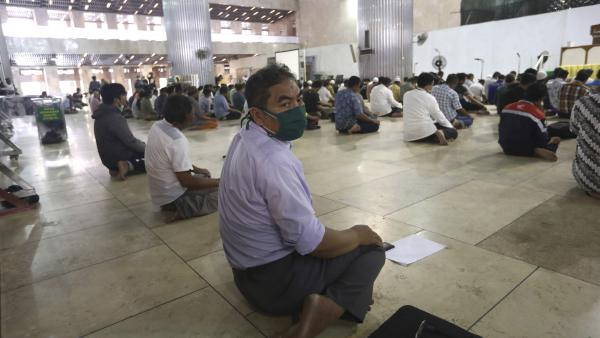 Men perform prayers at Istiqlal Mosque in Jakarta, Indonesia, on Friday.