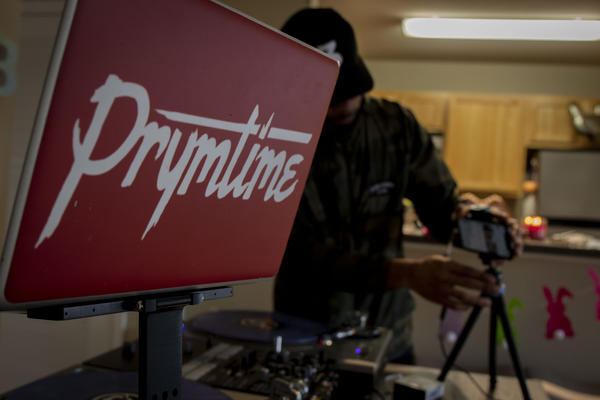 DJ Prymetime sets up equipment for his virtual party.