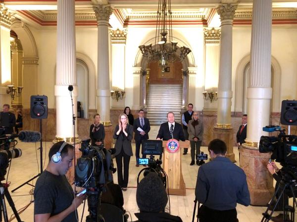 Gov. Jared Polis talks to reporters about the state's response to COVID-19 on Friday, March 20 at the state Capitol.