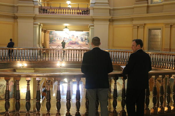 A limited number of people were allowed in the Statehouse this week to slow the spread of the coronavirus, but staffers, lobbyists and lawmakers still found time to chat at the rail.