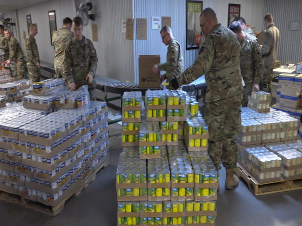 Members of the Ohio National Guard's 37th Infantry Brigade Combat Team out of Columbus package food at the Mid-Ohio Food Collective.