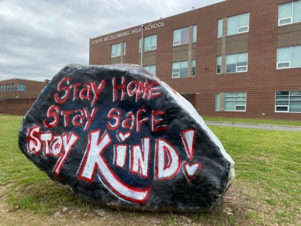 The rock outside South Mecklenburg High urges everyone to stay home, stay safe and stay kind.