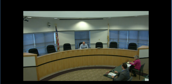 Pekin Mayor Mark Luft sits alone in the council chambers on Mon., March 23, 2020. The other members teleconferenced in to comply with mandates limiting the number of people in one room.