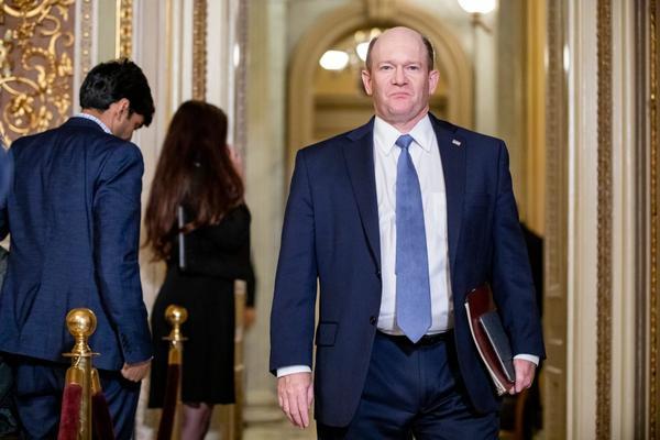 Sen. Chris Coons, Democrat of Delaware, walks through the halls of Congress.