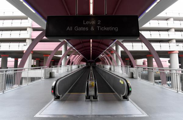 Airlines say they will likely have to lay off thousands of workers if Congress can't pass a coronavirus economic relief package soon. Amtrak, bus lines and subways are suffering, too. Above, an empty walkway at Las Vegas' McCarran International Airport on March 19, 2020.