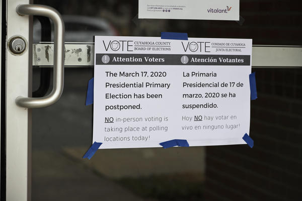 A sign at a polling location in Lyndhurst states how Ohio called off its primary election just hours before polls were set to open, an 11th-hour decision the governor said was necessary to prevent further fueling the coronavirus pandemic.