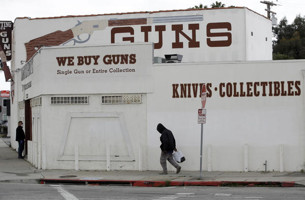 Guns are advertised for sale at a shop on Tuesday in Culver City, Calif. Los Angeles County Sheriff Alex Villanueva said he would like to see gun shops shut down.