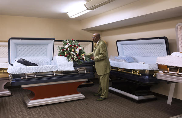 Ronald Jones adjusts a casket in his funeral home's display room in this May 16, 2018, file photo.