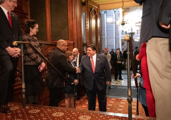 Gov. Pritzker enters the Illinois House chamber in February to deliver his budget address