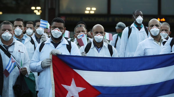 More than 50 doctors and paramedics arrived in Milan from Cuba on March 22 to help with coronavirus treatment.