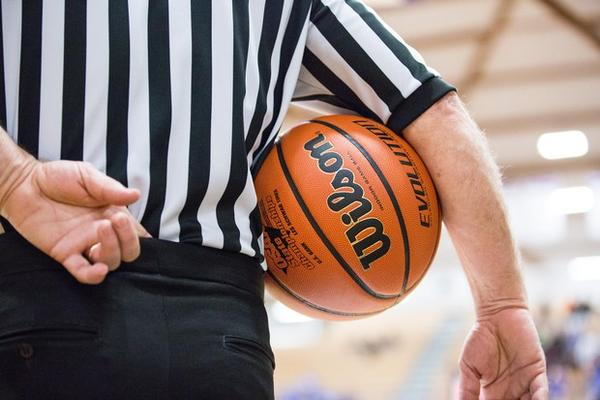 <p>A referee holds the ball in the quarterfinals of the OSAA 6A Boys Basketball Championships between Grant High School and West Salem High School at the Chiles Center in Portland, Oregon, Thursday, March 8, 2018.</p>