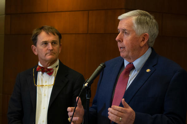 Governor Mike Parson and Health Director Randall Williams speak at a press conference at Columbia's city hall.