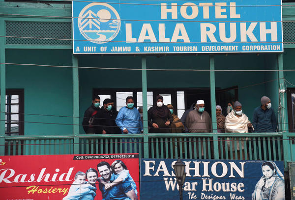 In quarantine at a hotel in Srinagar, India: A group of people who've returned from countries in the Middle East.