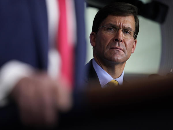 Defense Secretary Mark Esper listens as President Trump speaks during a news briefing with the Coronavirus Task Force at the White House last week.