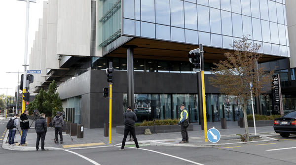 Media gather outside the Christchurch High Court in New Zealand Thursday local time, one year after a gunman killed 51 worshipers at two Christchurch mosques.