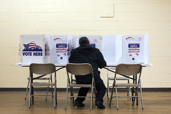 A voter fills out a ballot at Central Baptist Church on March 10, 2020.