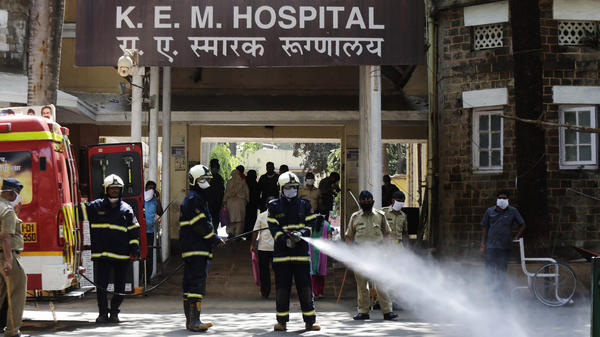 Fire brigade personnel sanitize a government hospital as part of precautionary measures against the coronavirus in Mumbai, India, on Tuesday.