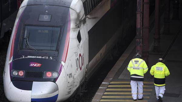 Emergency medical personnel walk by a high-speed TGV train in Strasbourg station on Wednesday, preparing to evacuate 20 COVID-19 patients to hospitals in western France.