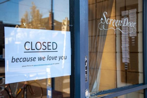 <p>A handmade&nbsp;closed sign taped to the&nbsp;window of one of&nbsp;Portland, Oregon's busiest restaurants, Screen Door.&nbsp;Their brunch and dinner&nbsp;lines usually stretch&nbsp;out the door and spill onto the sidewalk.&nbsp;On Monday, March 16, 2020, Gov. Kate Brown ordered restaurants and bars to stop all on-site dining and limit food sales to takeout and delivery service only to help prevent the spread of the new coronavirus.</p>