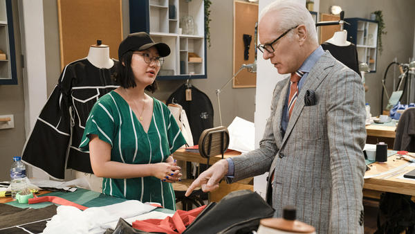 Tim Gunn and contestant Ji Won Choi talk over one of her designs on <em>Making The Cut. </em>