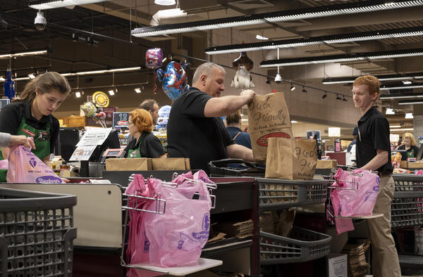 Employees at Dierbergs in Ballwin bag customer groceries. Local grocery stores have been particularly busy in recent weeks as shoppers rush to stock up on essentials during the COVID-19 pandemic.