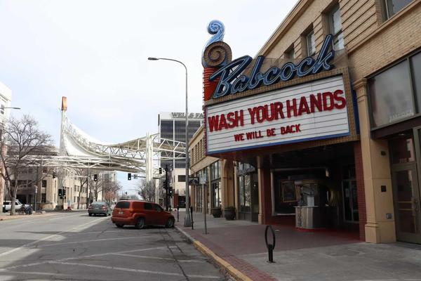 """The marque at the Babcock Theater in billings reads """"Wash Your Hands, We Will Be Back."""""""