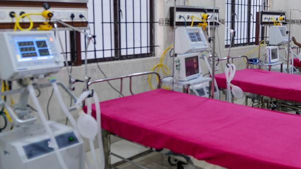 A staffer checks on a ventilator in an intensive care unit in Chennai, India, Friday. States in the U.S. are coming up with plans for what to do if they run out of ventilators and other supplies.