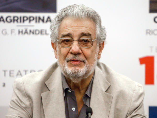 Opera singer Plácido Domingo, shown here speaking in Spain last July, said earlier this month that he tested positive for the coronavirus.