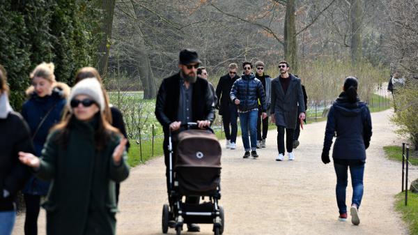 People walk in Frederiksberg Gardens in Copenhagen, Denmark, on March 28.