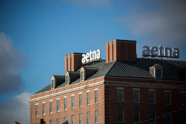 Aetna was the first insurer to announce its plan to help shield patients with COVID-19 from high medical bills. But out-of-network charges and other surprise bills remain a risk, say advocates for patients.