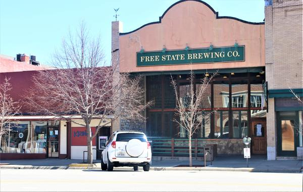 Empty parking places in front of the Free State Brewing Co. in Lawrence that would normally be full. The restaruant continues to serve take-out customers, but its dining rooms are closed.