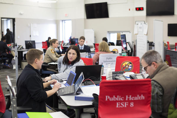 Teams work on responding to COVID-19 at the St. Louis County Office of Emergency Management in Ballwin on March 13, 2020.