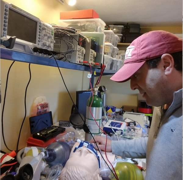 Worcester Polytechnic Institute Professor Greg Fischer works in his basement on a simple ventilator. (Courtesy)