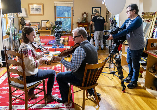Fiddlers Annie Stroud and Doug Van Gundy performing a tune that has been passed down for generations of fiddlers in Greenbrier County, W.Va. WVPB video crew films them for a short TV story.