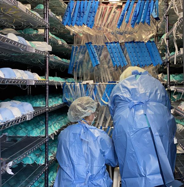 Battelle employees process N-95 masks in the Critical Care Decontamination System.