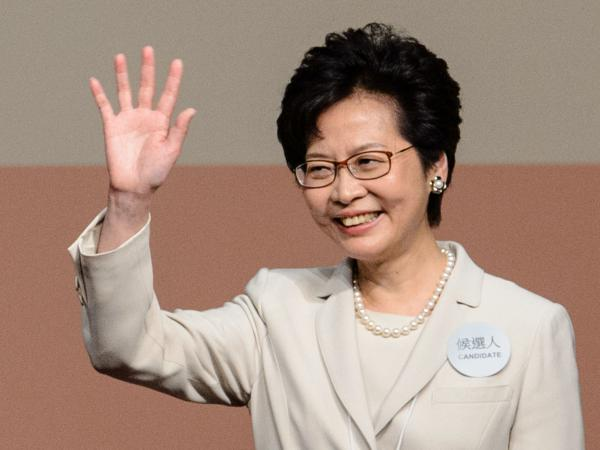 Hong Kong's new chief executive Carrie Lam waves after she won the Hong Kong chief executive election in Hong Kong on March 26, 2017. Hong Kong's new leader Carrie Lam pledged on March 26 to mend political rifts after winning a vote dismissed as a sham by democracy activists who fear the loss of the city's cherished freedoms.