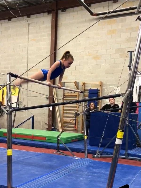 "Eight-year-old Adele at Silver Stars in Maryland. ""Gymnastics is her life,"" her mother Lowrey Redmond says."